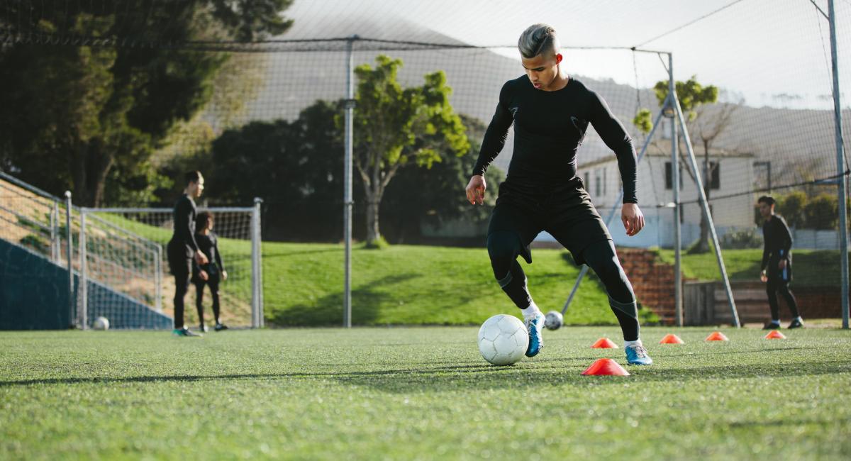 Soccer player dribbling ball